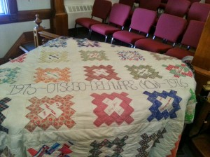 Quilt with squares naming famous historical feminists