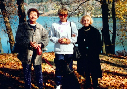 Left to Right: Joan Iversen, her sister, Dawn Danielson, and her mother, Jean McAtamney. Kali is in front.